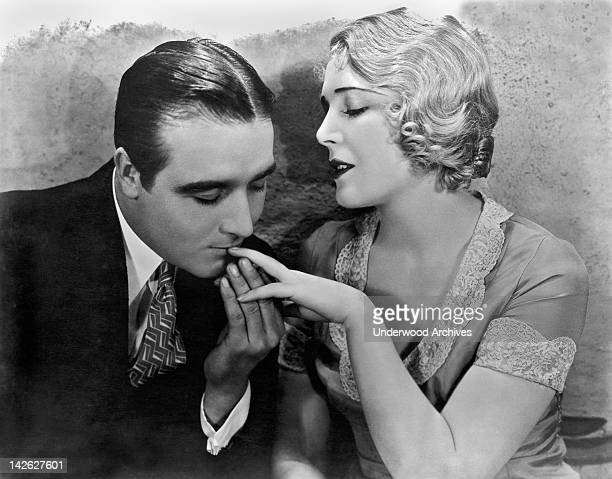 James Hall kisses Vilma Banky's fingertip in a scene from the film, 'This Is Heaven,' Hollywood, California, 1929.