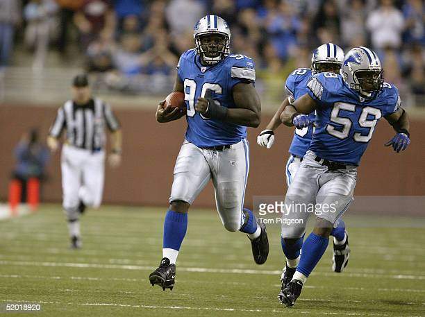 James Hall of the Detroit Lions carries the ball during the game against the Arizona Cardinals at Ford Field on December 5, 2004 in Detroit,...
