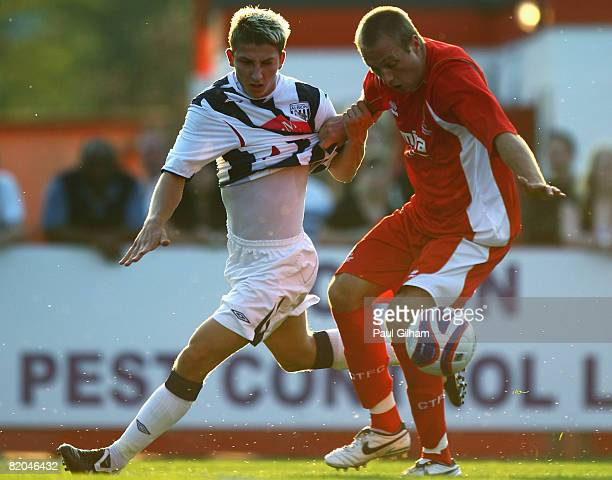 James Hancox of West Bromwich Albion battles for the ball with Paul Connor of Cheltenham Town during the Pre Season Friendly match between Cheltenham...