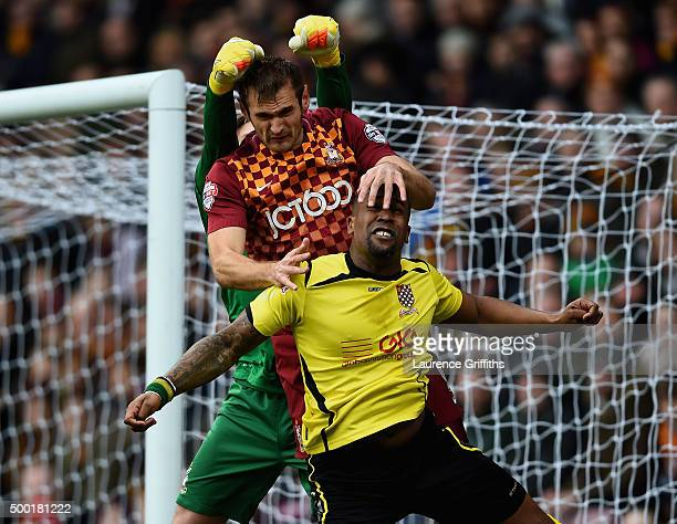 James Hanson of Bradford battles with Curtis Ujah of Chesham United during The Emirates FA Cup Second Round match between Bradford City and Chesham...