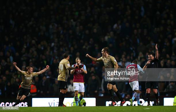 James Hanson of Bradford City celebrates victory as referee Phil Dowd ends the game