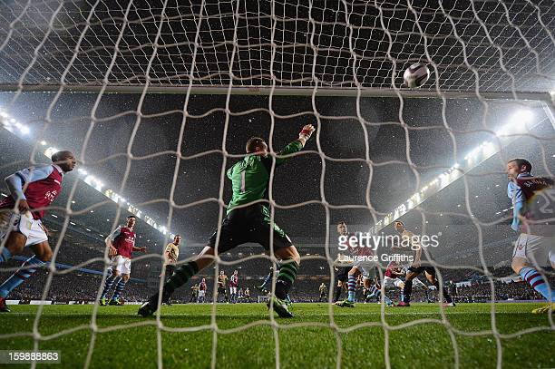James Hanson of Bradford City scores his team's first goal during the Capital One Cup Semi-Final Second Leg between Aston Villa and Bradford City at...
