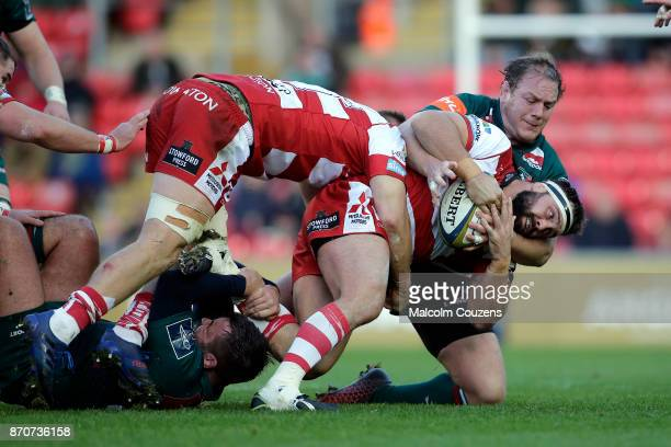 James Hanson of Gloucester Rugby is tackled by Pat Cilliers of Leicester Tigers during the AngloWelsh Cup tie between Leicester Tigers and Gloucester...