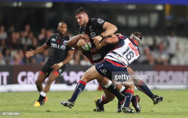 James Hanson of the Melbourne Rebels tackling Ruan Botha of the Cell C Sharks during the Super Rugby match between Cell C Sharks and Rebels at...
