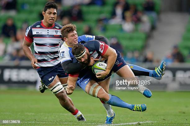 James Hanson of the Rebels is tackled by Brynard Stander of the Force during the round 14 Super Rugby match between the Rebels and the Force at AAMI...