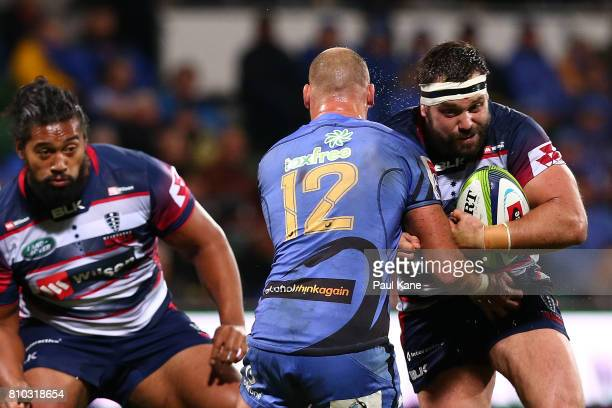 James Hanson of the Rebels looks to avoid being tackled by Billy Meakes of the Force during the round 16 Super Rugby match between the Force and the...
