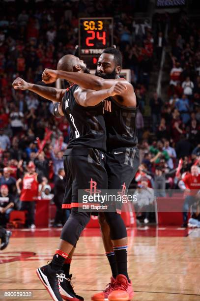 James Harden and Chris Paul of the Houston Rockets celebrate a win against the New Orleans Pelicans on December 11 2017 at the Toyota Center in...