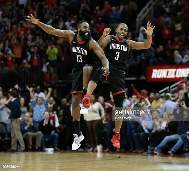 James Harden and Chris Paul of the Houston Rockets celebrate after Paul made a threepoint shot late in the fourth quarter Miami Heat at Toyota Center...