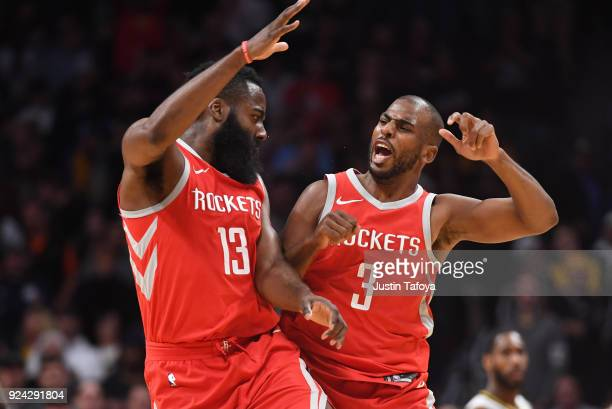 James Harden and Chris Paul of the Houston Rockets celebrate during a timeout against the Denver Nuggets at Pepsi Center on February 25 2018 in...