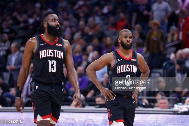 James Harden and Chris Paul of the Houston Rockets look on during the game against the Sacramento Kings at Golden 1 Center on April 2 2019 in...