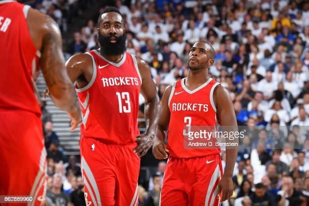 James Harden and Chris Paul of the Houston Rockets look on during the game against the Golden State Warriors on October 17 2017 at ORACLE Arena in...