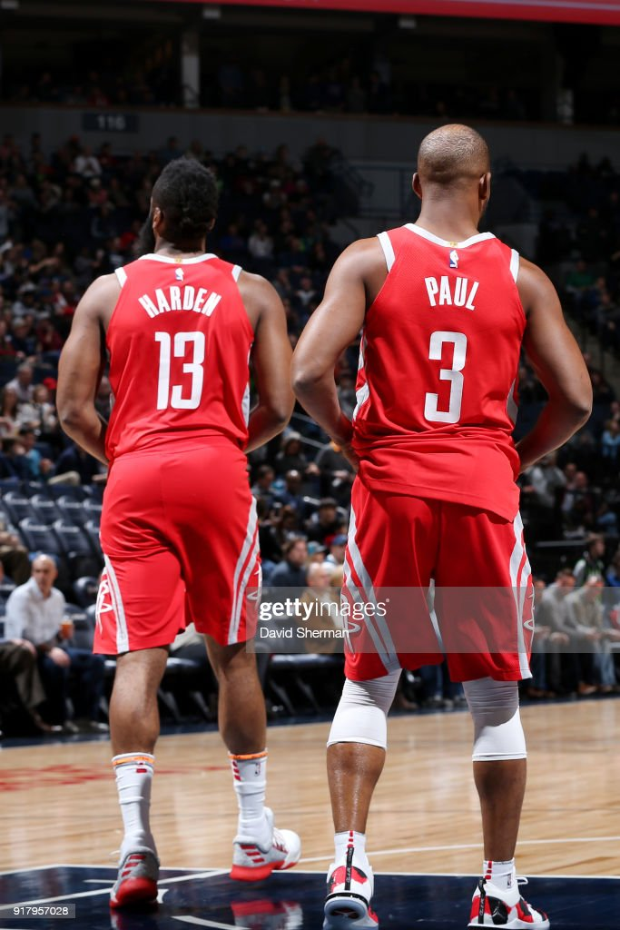 James Harden #13 and Chris Paul #3 of the Houston Rockets looks on during the game against the Minnesota Timberwolves on February 13, 2018 at Target Center in Minneapolis, Minnesota.