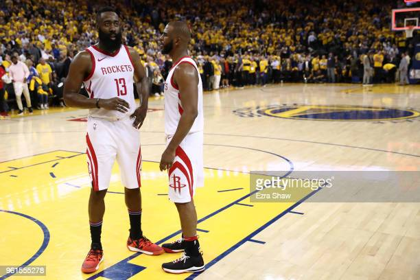 James Harden and Chris Paul of the Houston Rockets stand on the court as the officials review a play at the end of Game Four of the Western...