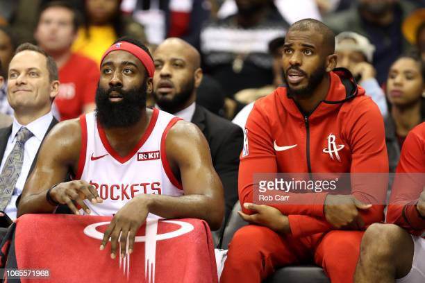 James Harden and Chris Paul of the Houston Rockets talk on the bench in the first half against the Washington Wizards at Capital One Arena on...