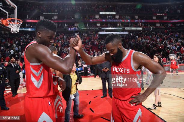 James Harden and Clint Capela of the Houston Rockets high five after the game against the Cleveland Cavaliers on NOVEMBER 9 2017 at the Toyota Center...