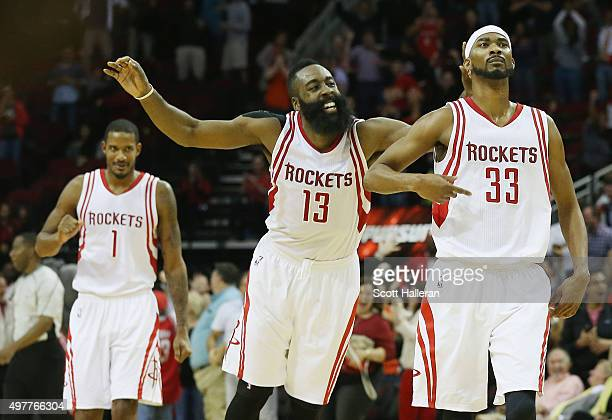 James Harden and Corey Brewer of the Houston Rockets celebrate after Brewer hit a threepoint shot near the end of the fourth quarter against the...