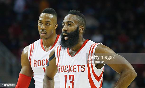James Harden and Dwight Howard of the Houston Rockets wait on the court during the game against the Philadelphia 76ers at the Toyota Center on...
