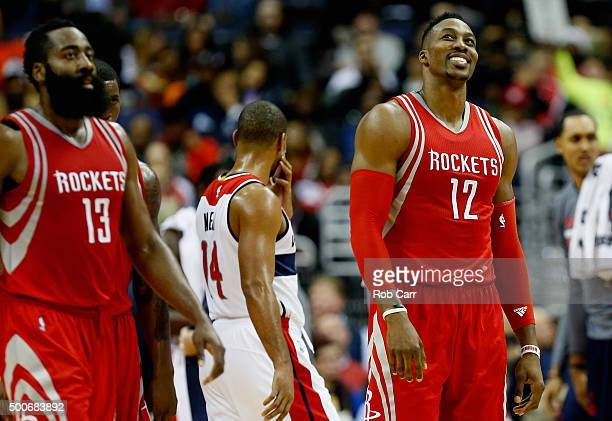 James Harden and Dwight Howard of the Houston Rockets walk off the court during a first half timeout against the Washington Redskins at Verizon...