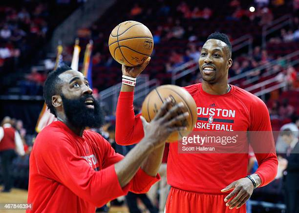 James Harden and Dwight Howard of the Houston Rockets warm up on the court before their game against the Minnesota Timberwolves at the Toyota Center...