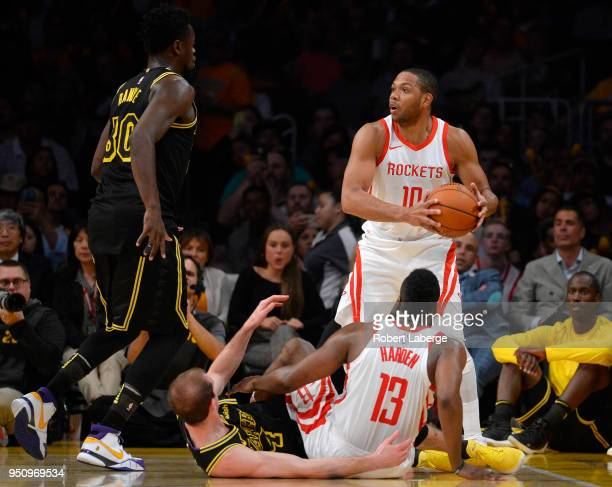 James Harden and Eric Gordon of the Houston Rockets fight for the ball with Alex Caruso of the Los Angeles Lakers on April 10 2018 at STAPLES Center...