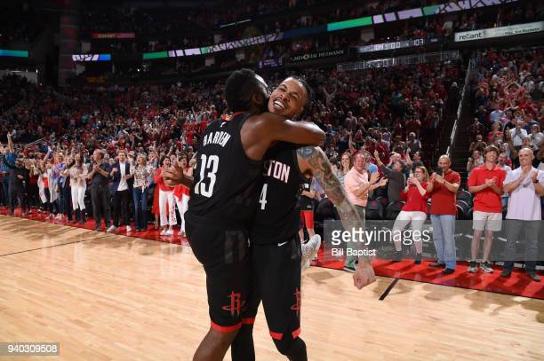 James Harden and Gerald Green of the Houston Rockets celebrate a win against the Phoenix Suns on March 30 2018 at the Toyota Center in Houston Texas...