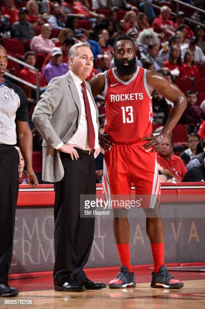 James Harden and Head Coach Mike D'Antoni of the Houston Rockets looks on during the game against the Philadelphia 76ers on October 30 2017 at the...