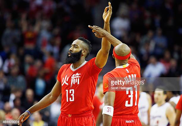 James Harden and Jason Terry of the Houston Rockets reacts to a play during their game against the Los Angeles Clippers at the Toyota Center on...
