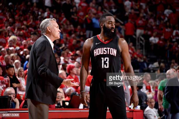 James Harden and Mike D'Antoni of the Houston Rockets talk during the game against the Golden State Warriors in Game One of the Western Conference...