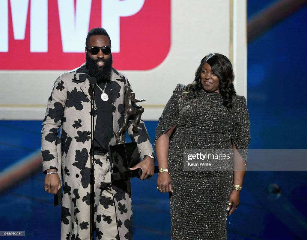 James Harden (L) and Monja Willis speak onstage at the 2018 NBA Awards at Barkar Hangar on June 25, 2018 in Santa Monica, California.
