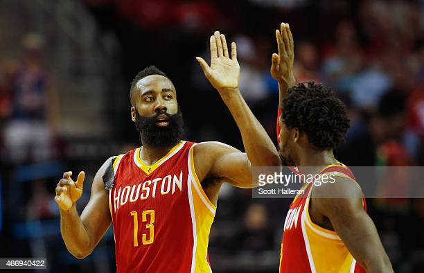 James Harden and Patrick Beverley of the Houston Rockets celebrate after Harden hit a three-point shot during their game against the Denver Nuggets...