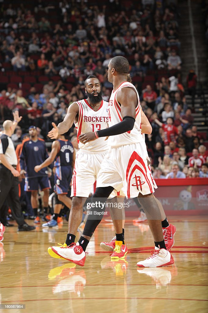 James Harden #13 and Patrick Patterson #54 of the Houston Rockets celebrate a win against the Charlotte Bobcats on February 2, 2013 at the Toyota Center in Houston, Texas.