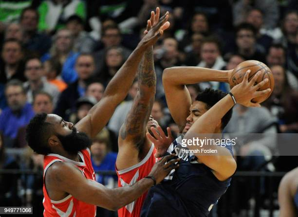 James Harden and PJ Tucker of the Houston Rockets defend against KarlAnthony Towns of the Minnesota Timberwolves during the first quarter in Game...