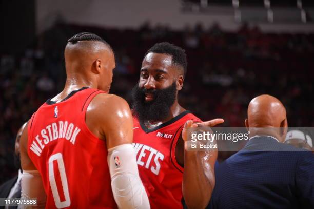 James Harden and Russell Westbrook of the Houston Rockets talk during a game against the Milwaukee Bucks on October 24 2019 at the Toyota Center in...