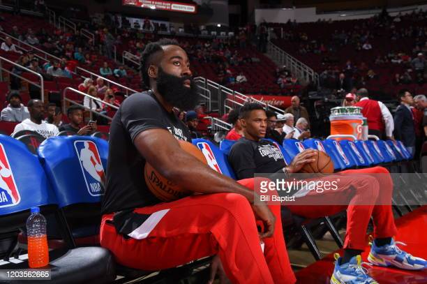 James Harden and Russell Westbrook of the Houston Rockets warm up prior to a game against the Memphis Grizzlies on February 26 2020 at the Toyota...