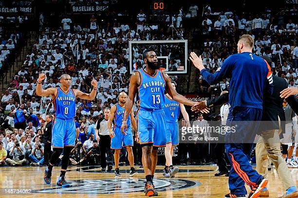James Harden and Russell Westbrook of the Oklahoma City Thunder celebrate while playing against the San Antonio Spurs in Game Five of the Western...