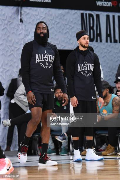 James Harden and Stephen Curry of Team Stephen look on during NBA AllStar Media Day Practice as part of 2018 NBA AllStar Weekend at the Los Angeles...