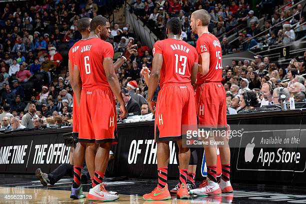 James Harden and the Houston Rockets huddle up during the game against the San Antonio Spurs at the ATT Center on December 25 2013 in San Antonio...