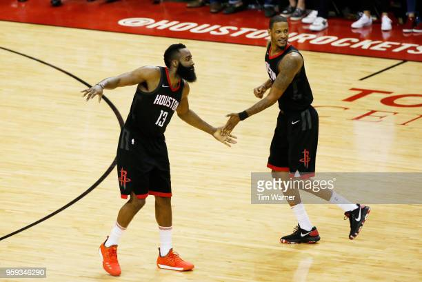 James Harden and Trevor Ariza of the Houston Rockets react in the fourth quarter against the Golden State Warriors of Game Two of the Western...