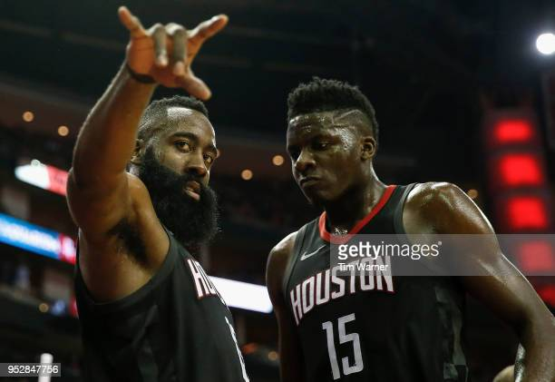 James Harden celebrates with teammate Clint Capela of the Houston Rockets during a time out in the second half during Game One of the Western...