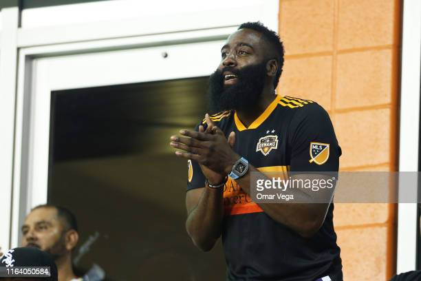 James Harden cheers for his team Dynamo during the quarterfinals match between Club America and Houston Dynamo as part of the Leagues Cup 2019 at...