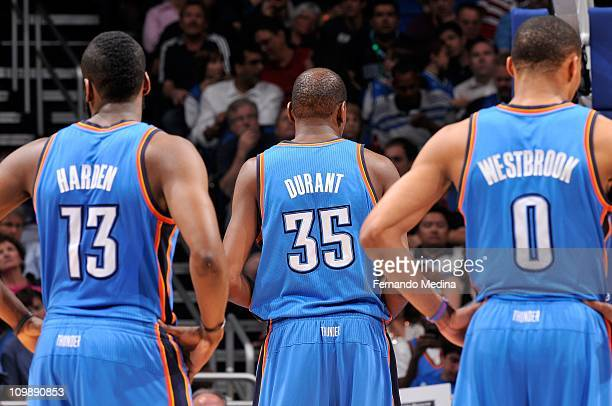 James Harden Kevin Durant and Russell Westbrook of the Oklahoma City Thunder stand on the court during the game against the Orlando Magic on February...