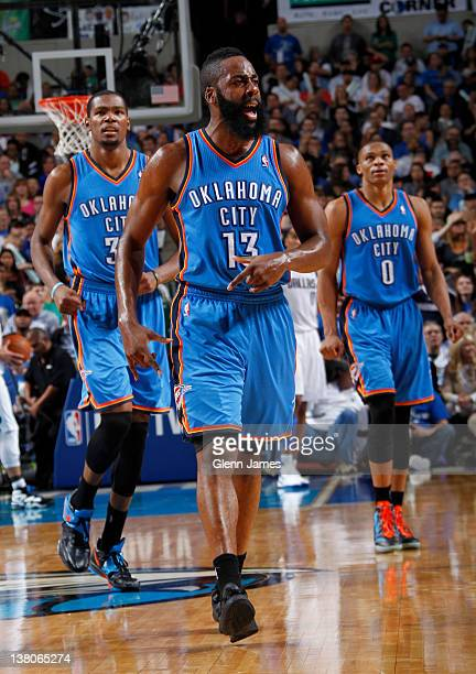 James Harden Kevin Durant and Russell Westbrook of the Oklahoma City Thunder celebrate a win against the Dallas Mavericks on February 1 2012 at the...
