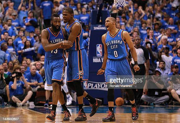 James Harden Kevin Durant and Russell Westbrook of the Oklahoma City Thunder celebrate after scoring with 10 seconds against the Dallas Mavericks...