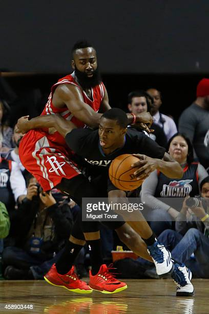 James Harden of Houston Rockets defends Andrew Wiggins of Minnesota Timberwolves during a game between Minnesota Timberwolves and Houston Rockets as...