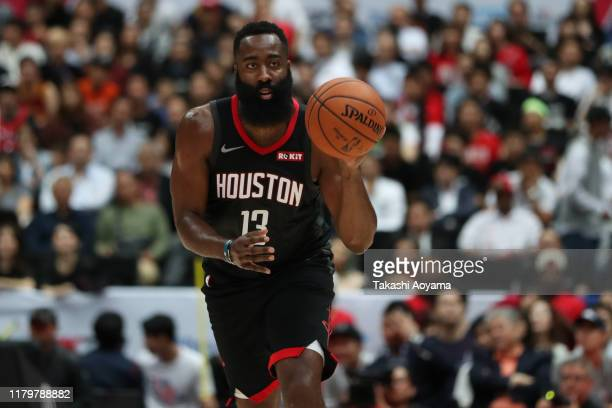 James Harden of Houston Rockets dribbles the ball during the preseason game between Houston Rockets and Toronto Raptors at Saitama Super Arena on...
