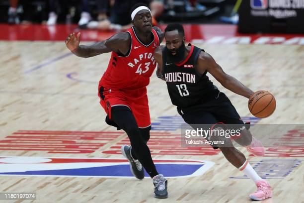 James Harden of Houston Rockets drives to the basket against Pascal Siakam of Toronto Raptors during the preseason match between Toronto Raptors and...