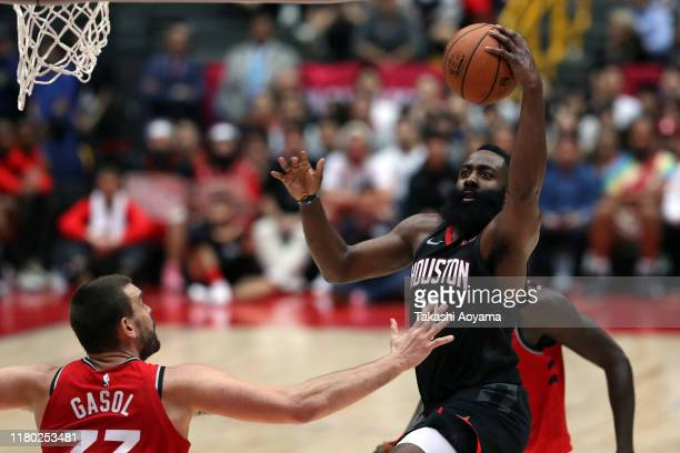 James Harden of Houston Rockets shoots against Marc Gasol of Toronto Raptors during the preseason game between Toronto Raptors and Houston Rockets at...