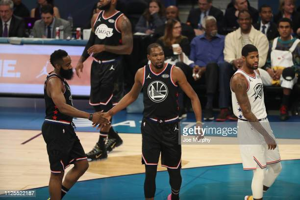 James Harden of Team Lebron celebrates with Kevin Durant of Team Lebron during the 2019 NBA AllStar Game on February 17 2019 at the Spectrum Center...