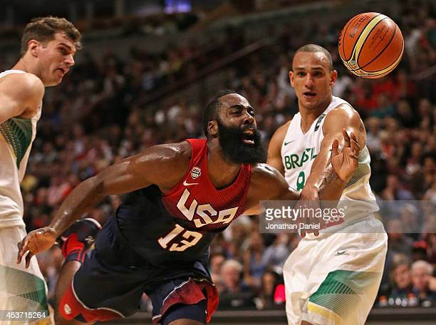 James Harden of team USA loses the ball after being fouled by Alex Garcia of team Brazil during an exhibition game at the United Center on August 16...