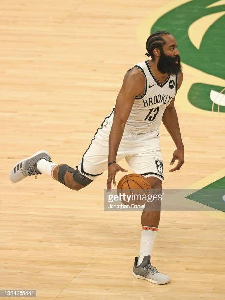 James Harden of the Brooklyn Nets brings the ball up the court against the Milwaukee Bucks at Fiserv Forum on June 17, 2021 in Milwaukee, Wisconsin....